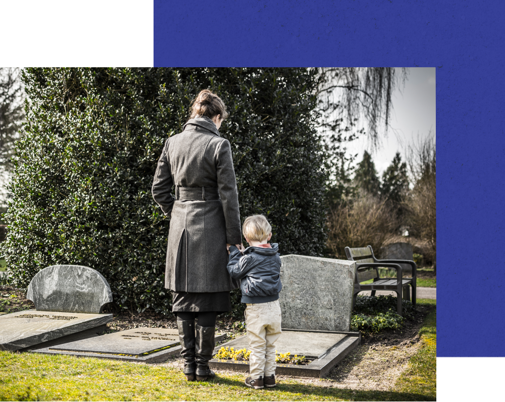 woman and child visiting graveyard