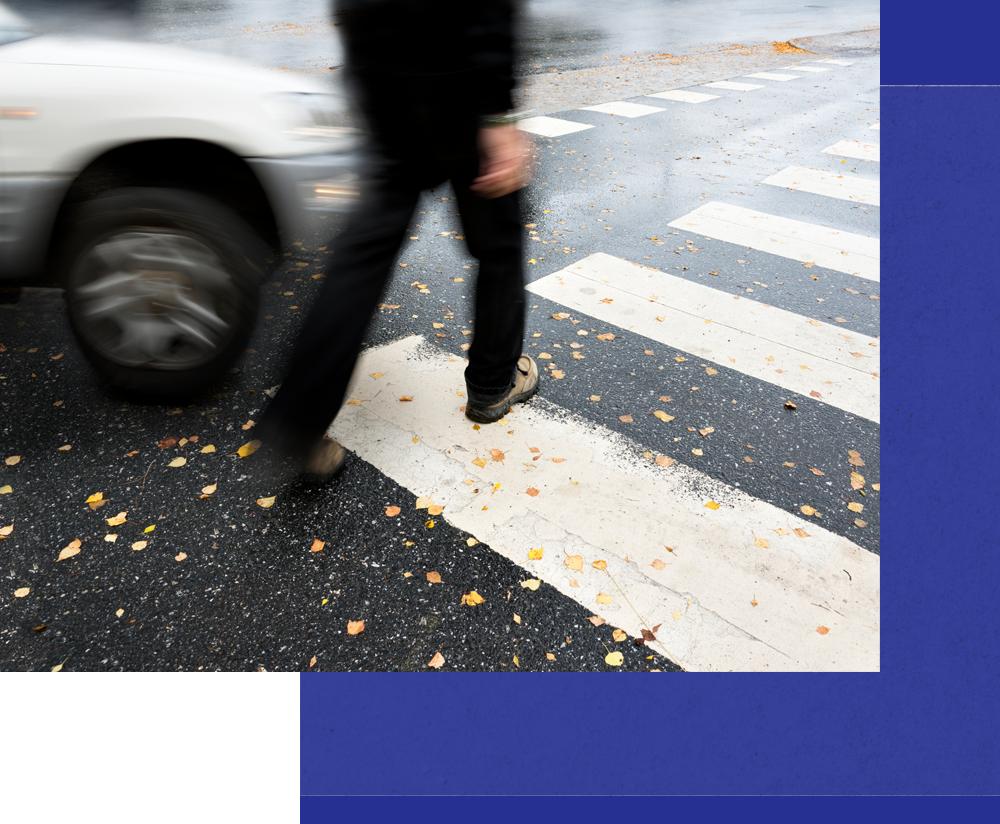 pedestrian walking in crosswalk and car almost striking