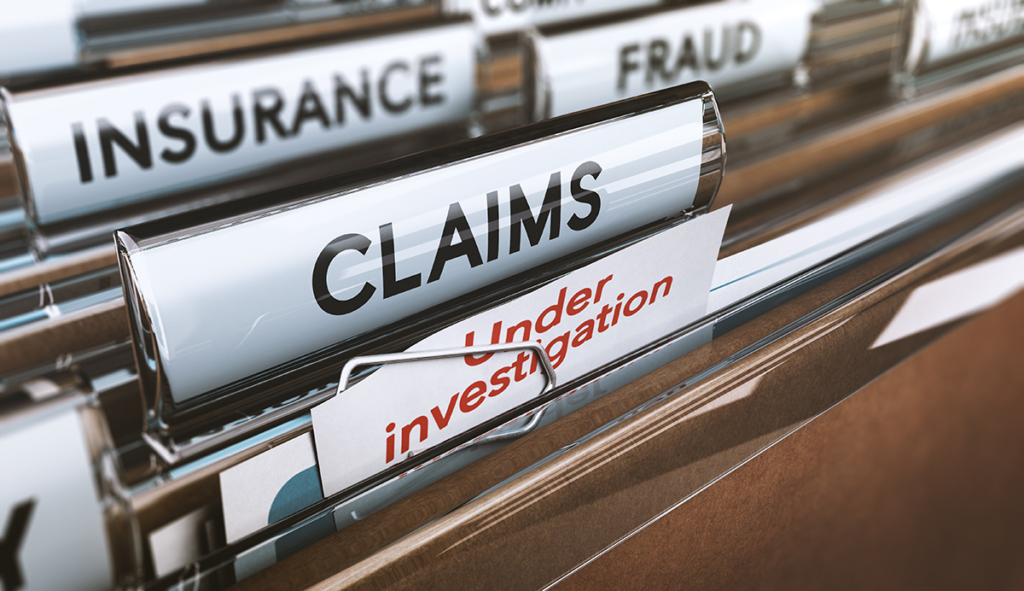 image of insurance files marked wit claims under investigation fraud