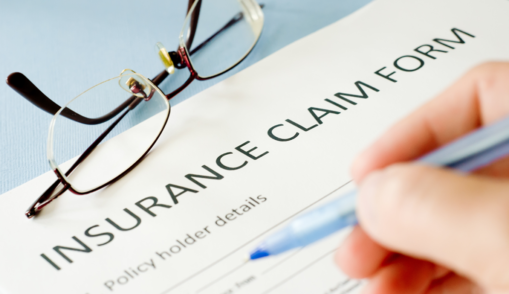 image of insurance claim form with text reading policy holder details